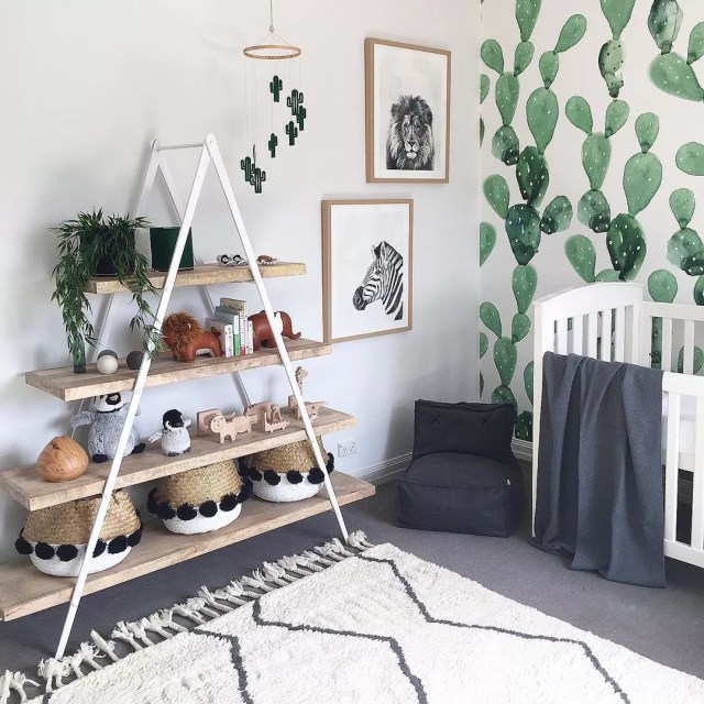a fram shelf with baskets and trinkets on it with rug on floor photo by Instagram user @liberty.interiors