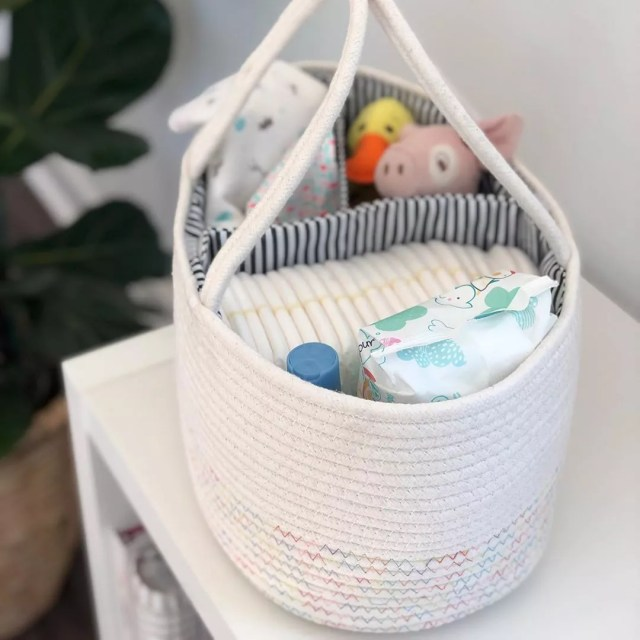 bag with diapers and stuffed animals photo by Instagram user @lifesmilesllc