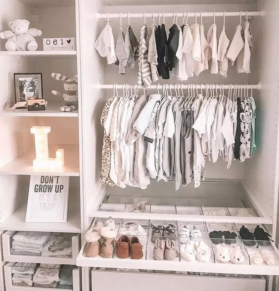 baby closet with extra items installed with clothes hanging photo by Instagram user @jessandjonesnursery
