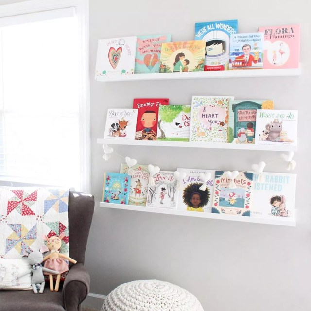 gray wall with small bookshelves installed and chair in corner photo by Instagram user @leesieandpip