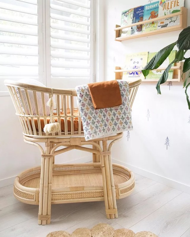 Wood bassinet in nursery corner. Photo by Instagram user @venitawilsonphotography
