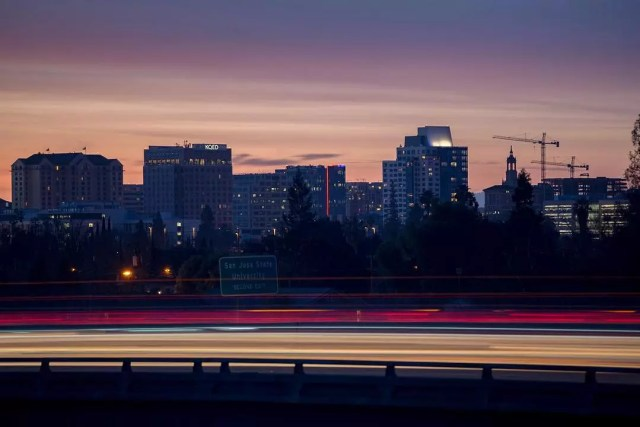 downtown San Jose at dusk with highway in foreground photo by Instagram user @janitorty