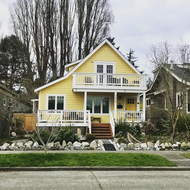 yellow craftsman style home in west seattle photo by Instagram user @dblh206