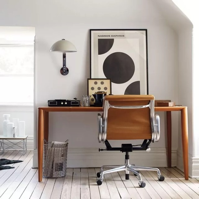 leather rolling desk chair at wooden desk photo by Instagram user @dwrtom