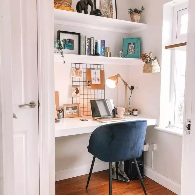 small home office space with small desk lamp and blue chair photo by Instagram user @prem_777