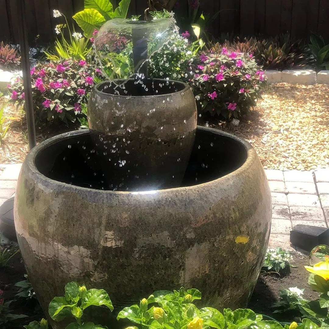 small backyard fountain built from old pots photo by Instagram user @zapata.thalia