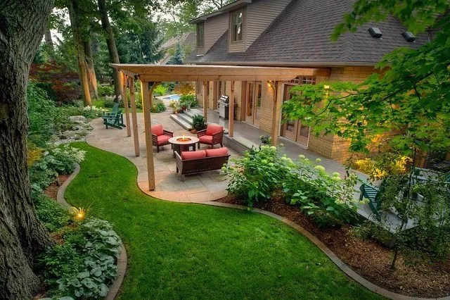 well landscaped backyard with outdoor living space and pergola photo by Instagram user @maritimewestconstruction