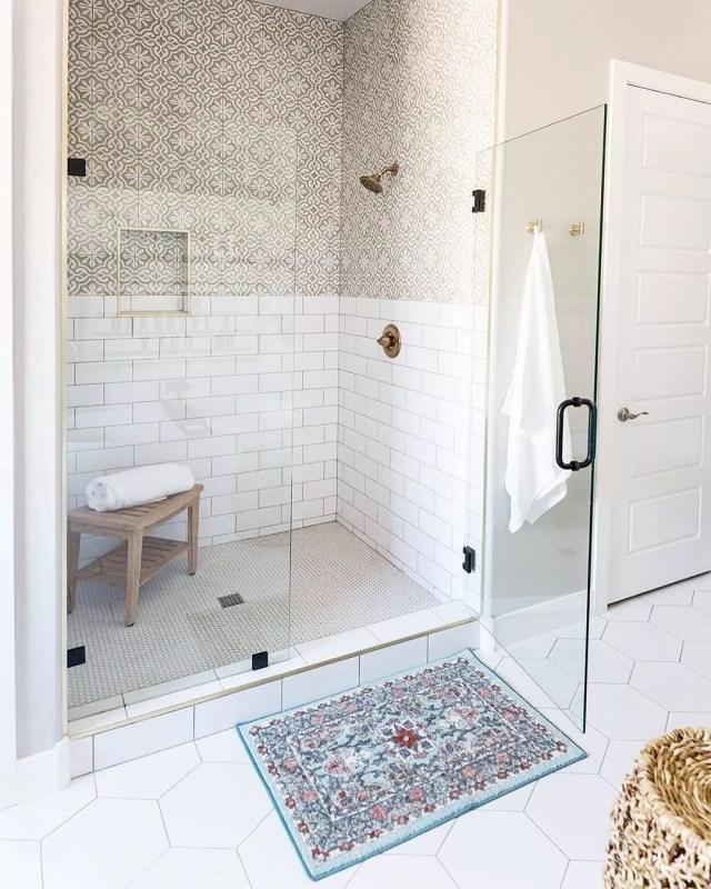 updated shower with glass pane doors and new tile photo by Instagram user @kimberleykayinteriors
