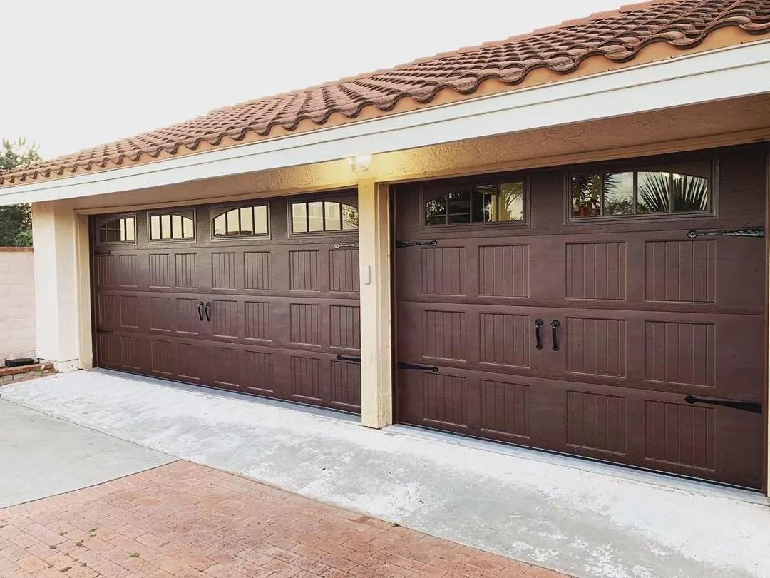 new garage doors with windows installed photo by Instagram user @rockstargaragedoorservices