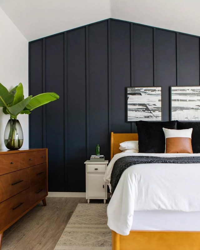 feature wall with blue board and batten in bedroom photo by Instagram user @highandtightdesign