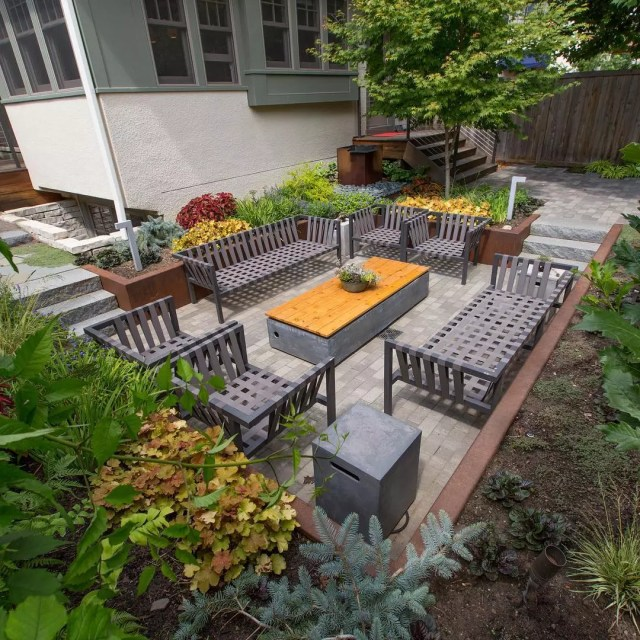 sunken patio added to small backyard with gray furniture photo by Instagram user @phillipsgarden