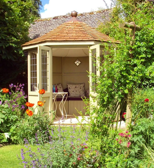 backyard shed with seating space in garden photo by Instagram user @scotts_of_thrapston