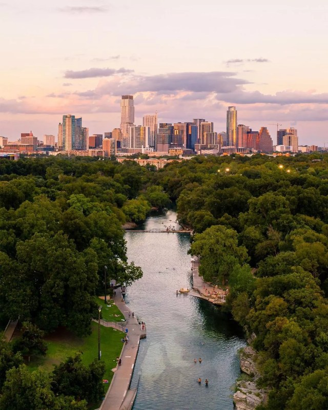 View of Downtown Austin from the Barton Springs Pool. Photo by Instagram user @flowkyte