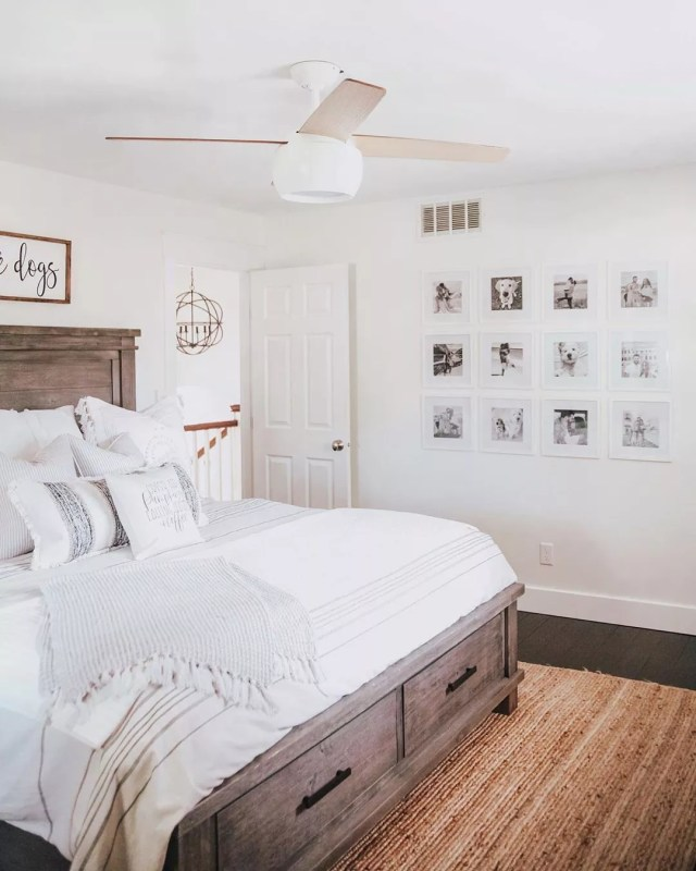 clean bedroom with gallery wall with dog photos and updated wood flooring photo by Instagram user @fashionablykay
