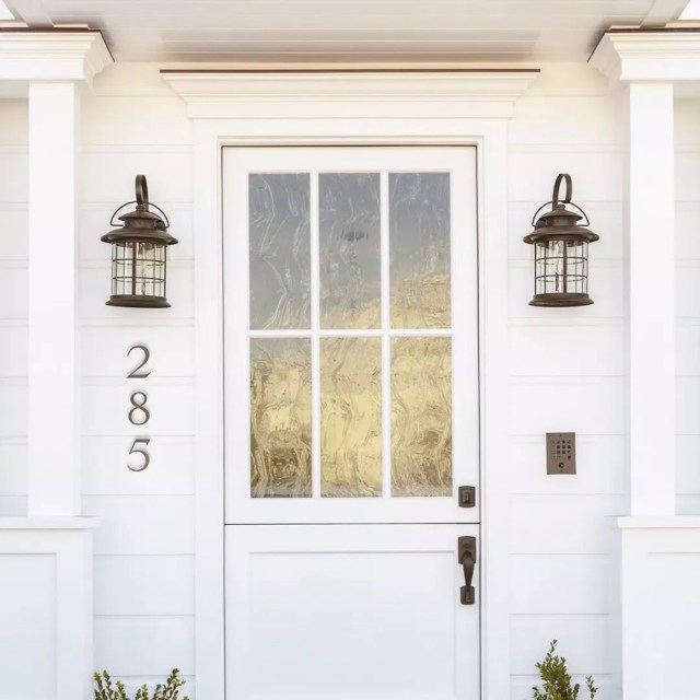white front door and siding with new brushed nickel house numbers photo by Instagram user @dropcap_studio