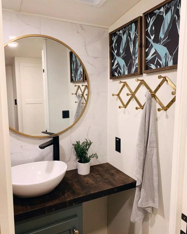 new bathroom vanity and mirror in RV photo by Instagram user @karleemmarsh