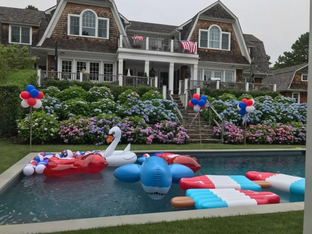 Backyard Pool Filled with Summer Style Inflatables. Photo by Instagram user @simply_perfect_events