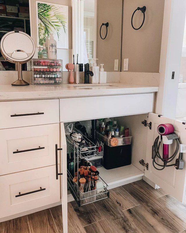 Storage added to the back of vanity cabinet doors in the bathroom. Photo by Instagram user @tiffanyish