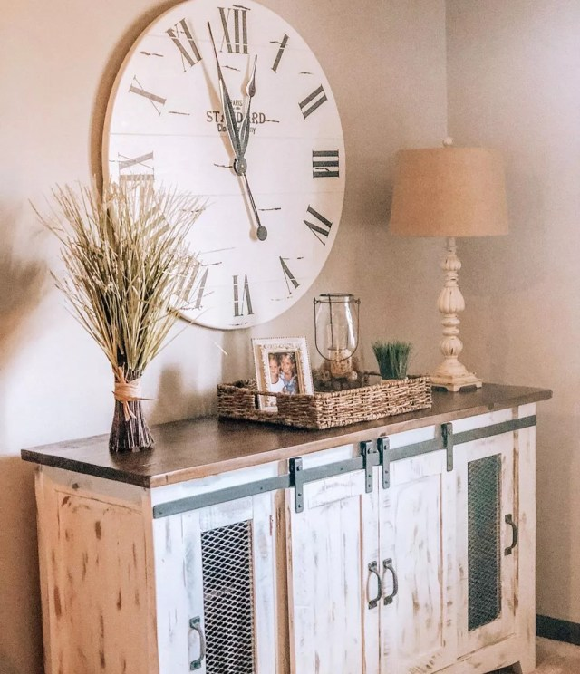 Sideboard with sliding farm doors installed to hide items. Photo by Instagram user @myfarmhouseheritage