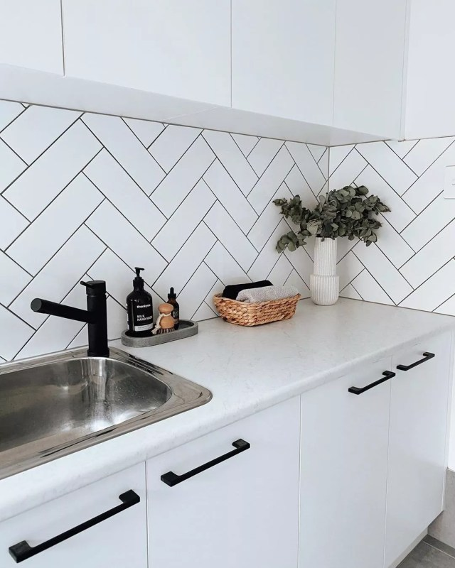 Updated Kitchen with White Cabinets and Subway Tile Backsplash. Photo by Instagram user @housetwentyfive