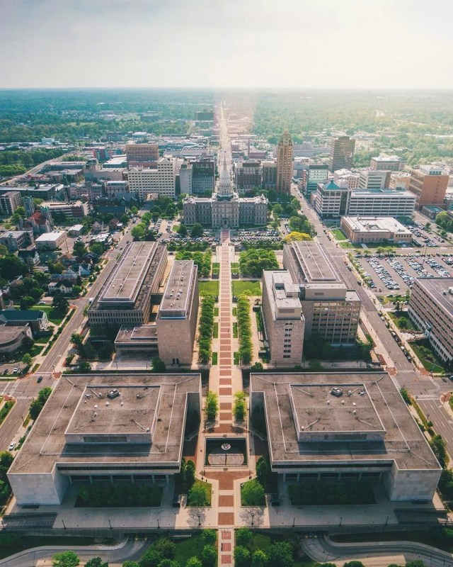 Aerial View of Downtown Lansing, MI and the Michigan State House. Photo by Instagram user @drewmason