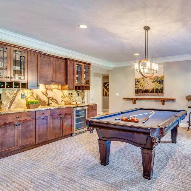 Updated Basement with a Pool Table and Bar Area. Photo by Instagram user @stanleymartinhomes