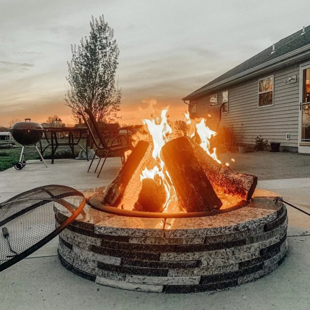 Backyard Fire Pit with Burning Logs. Photo by Instagram user @fitswearingen
