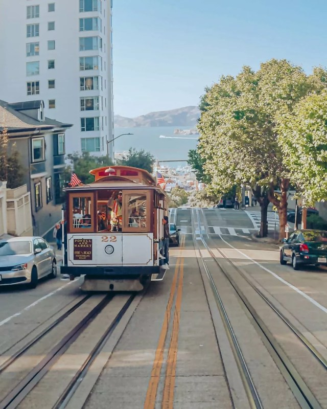 Street Trolley Going Up the Hill in San Francisco, CA. Photo by Instagram user @the_life_of_purple_rose