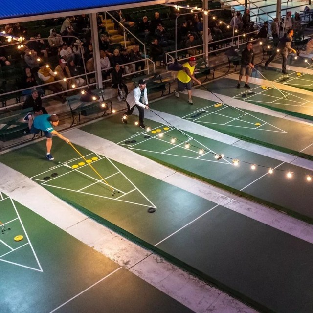 People Outside Playing Shuffleboard at a Club. Photo by Instagram user @stpeteshuffle