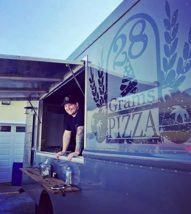 Man Standing Inside of the 28 Grams Pizza Food Truck. Photo by Instagram user @jayveehave