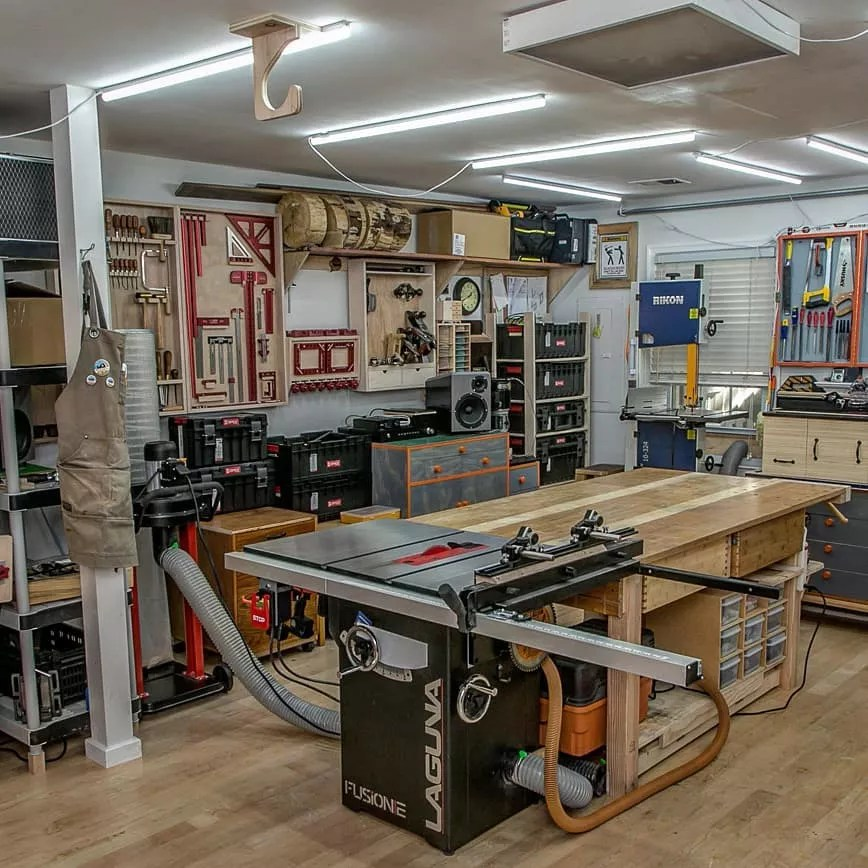 Well Organized Home Workshop with Work Bench and Table Saw Set Up. Photo by Instagram user @radeksworkshop