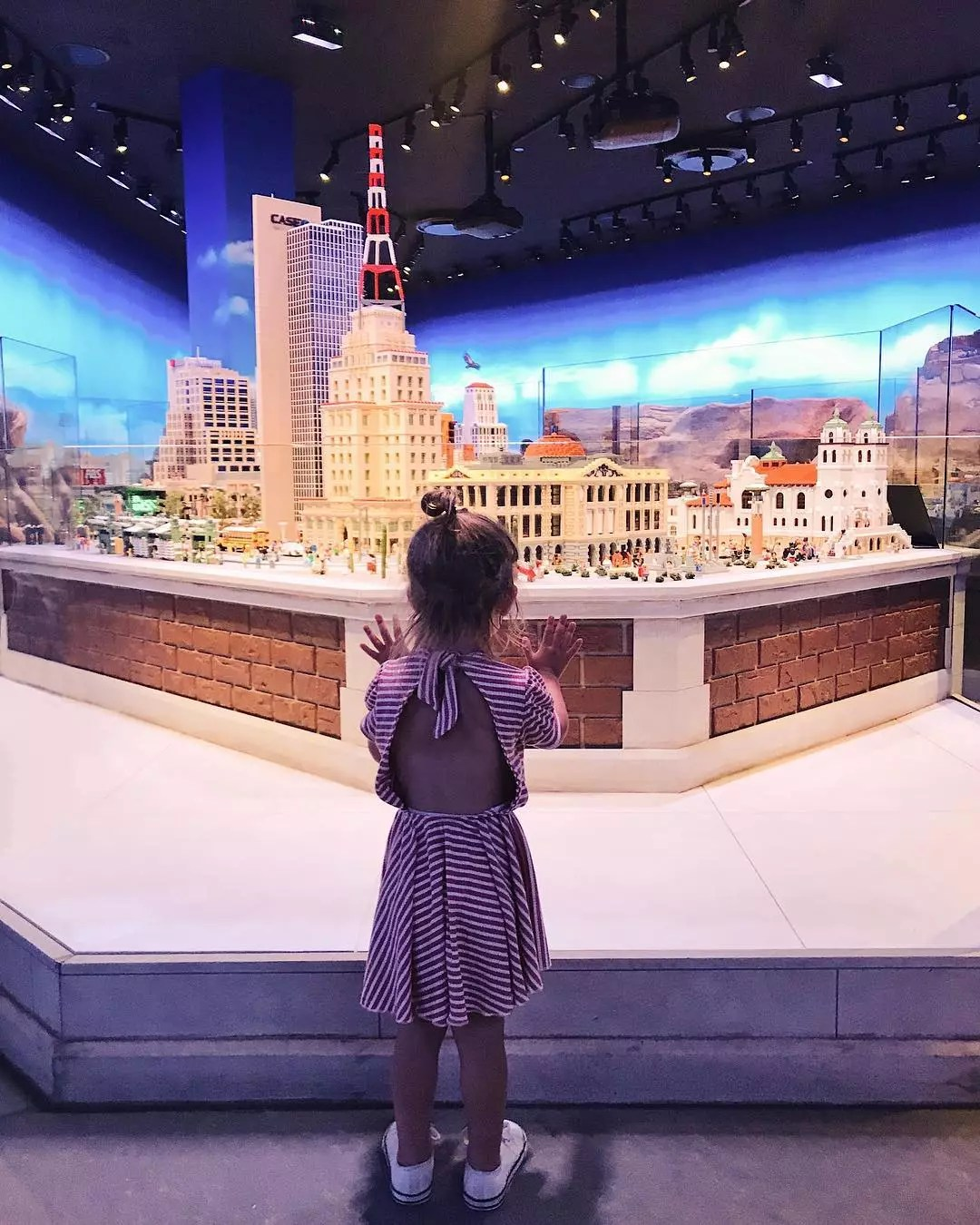 Little Girl Looking at a Downtown Tempe Made of LEGO. Photo by Instagram user @kcstauffer
