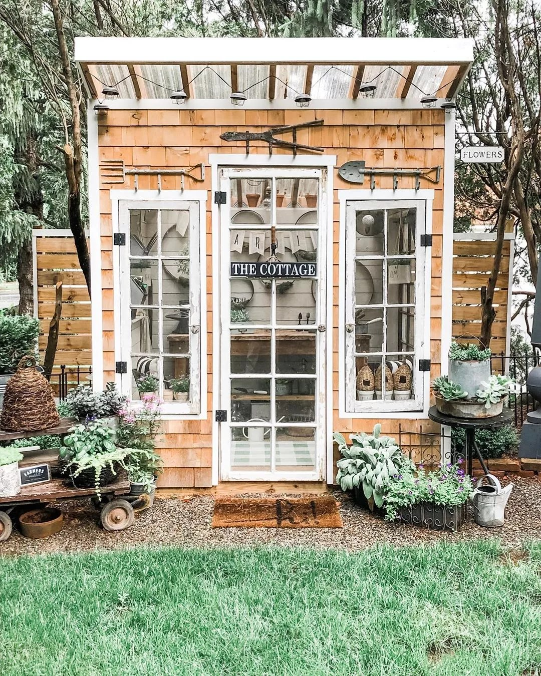 Small Wooden Shingle Sided Garden She Shed. Photo by Instagram user @cottageandbloom