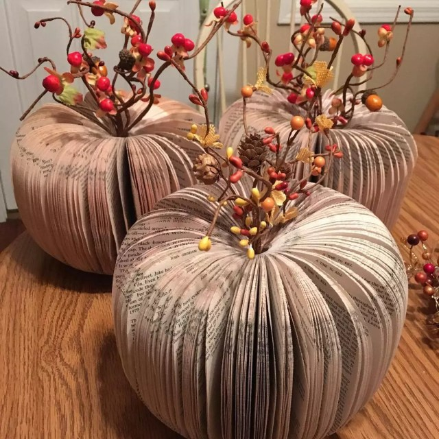Pumpkins Made Out of Recycled Books with Decorations Atop. Photo by Instagram user @madconcoctions