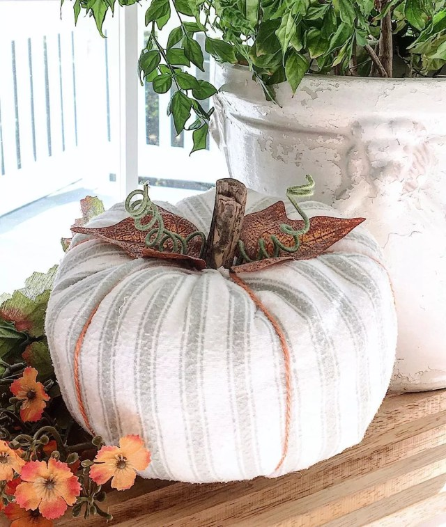 Cloth Pumpkin On a Front Porch. Photo by Instagram user @passionateforwhite