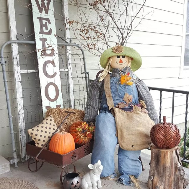 Stuffed Home Made Scarecrow Sitting on a Front Porch. Photo by Instagram user @homedecordoneonabudget