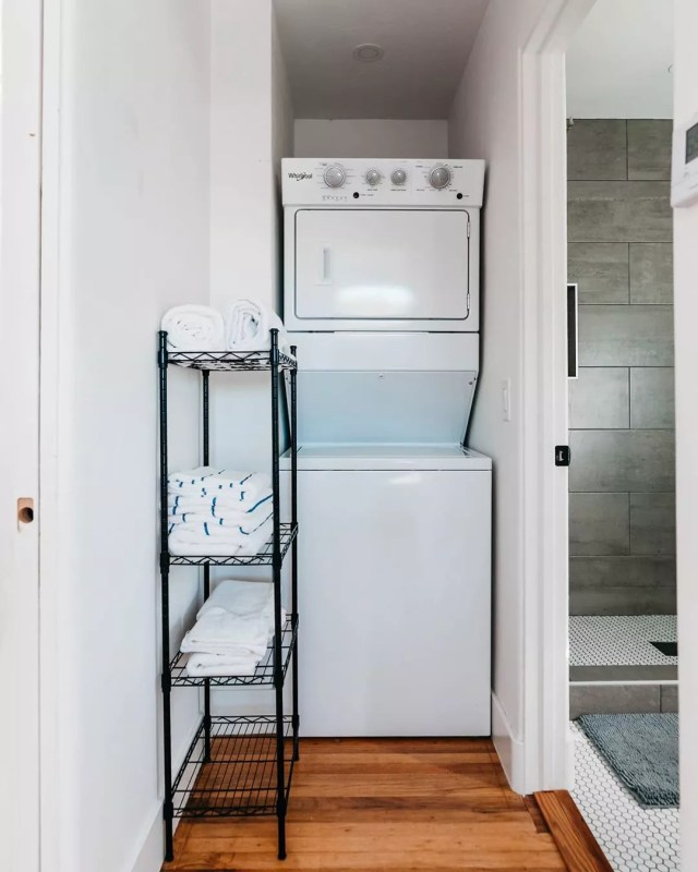 Stacked Washer and Dryer Next to Bathroom. Photo by Instagram user @thehillcresthavenairbnb