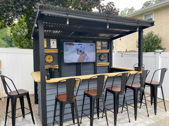 Backyard Bar Area with TV and Large Barstools. Photo by Instagram user @taverns_to_go