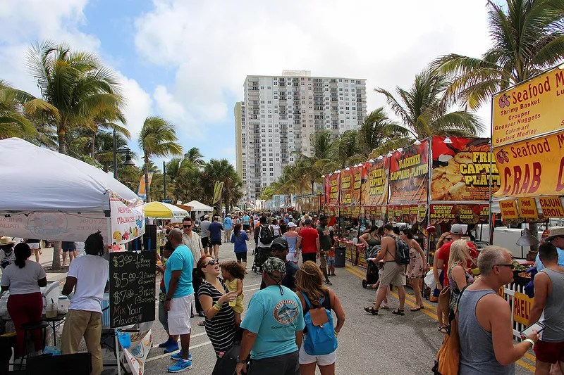 People Walking Up the Street at the Pompano Beach Sea Food festival. Photo by Instagram user @pompanobeachseafoodfest