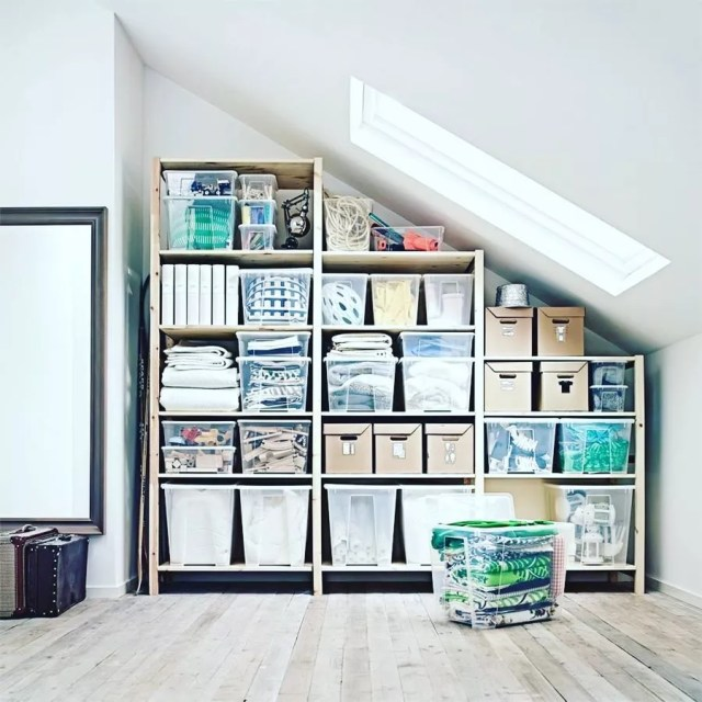 Attic Storage Space with Wooden Shelves and Clear Totes. Photo by Instagram user @inordertosucceed