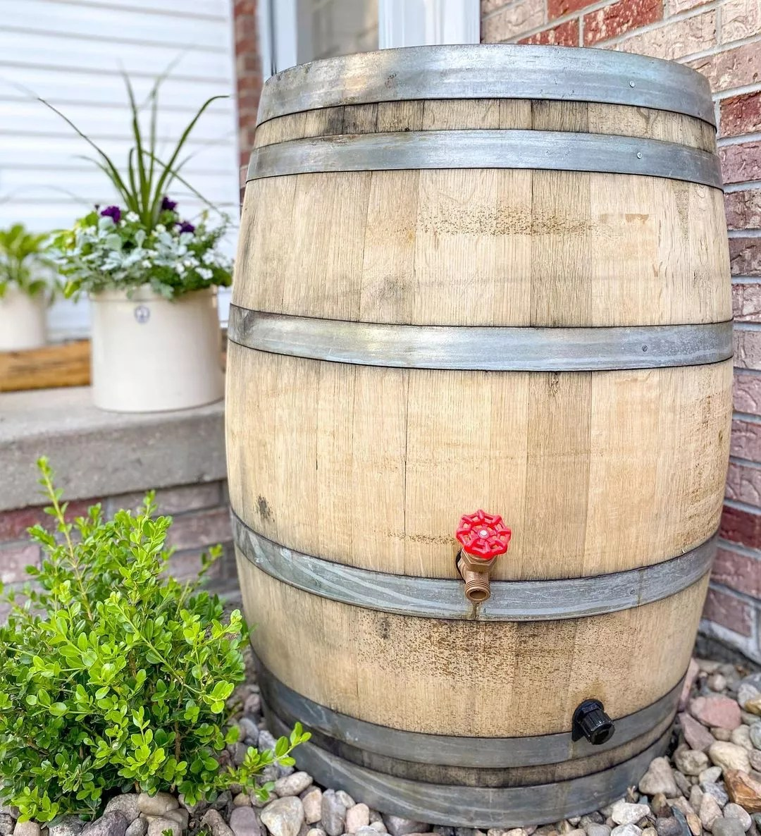 Wooden Barrel Designed to Be an Outdoor Rain Water Catcher. Photo by Instagram user @midwestlifeandstyle