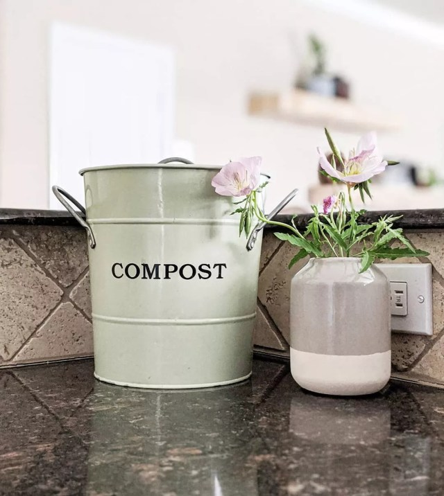 Small Compost Bucket Sitting on Kitchen Counter. Photo by Instagram user @pursuing.roots