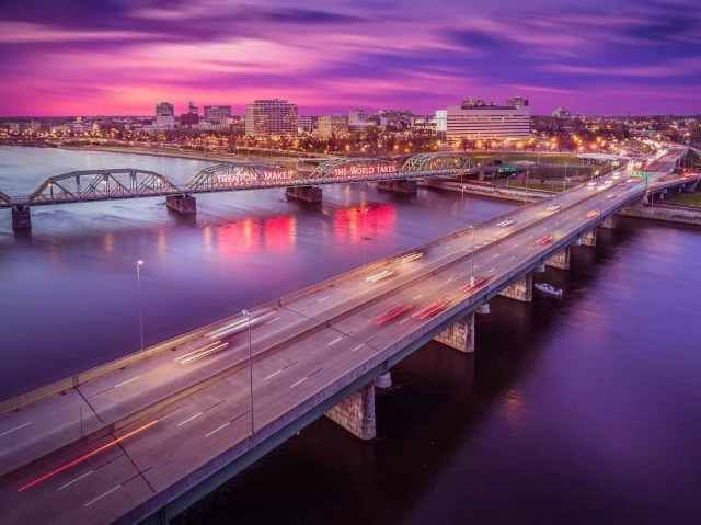 """Drone photo of twilight time lapse of Downtown Trenton, NJ, featuring the famous """"Trenton Makes, the World Takes"""" sign alit on the bridge. Photo by Instagram user @fotosforthefuture_drone"""