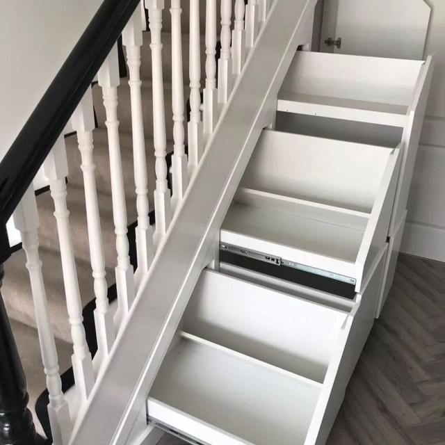 Empty drawers that pull out from underneath the stairs. Photo by Instagram User @accurideus