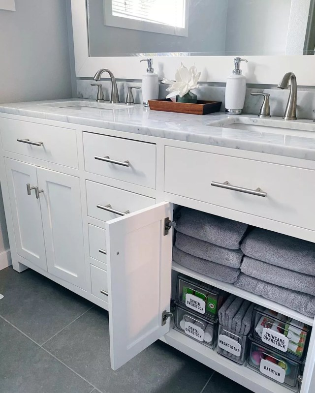Renovated Bathroom with Under Sink Storage Containers. Photo by Instagram user @theorderlyspace
