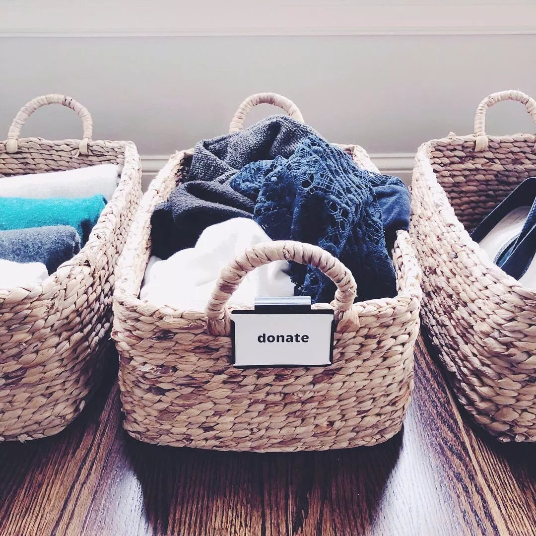 "Baskets with decluttered objects in them; the middle basket says ""donate."" Photo by Instagram user @neatlittlenest."