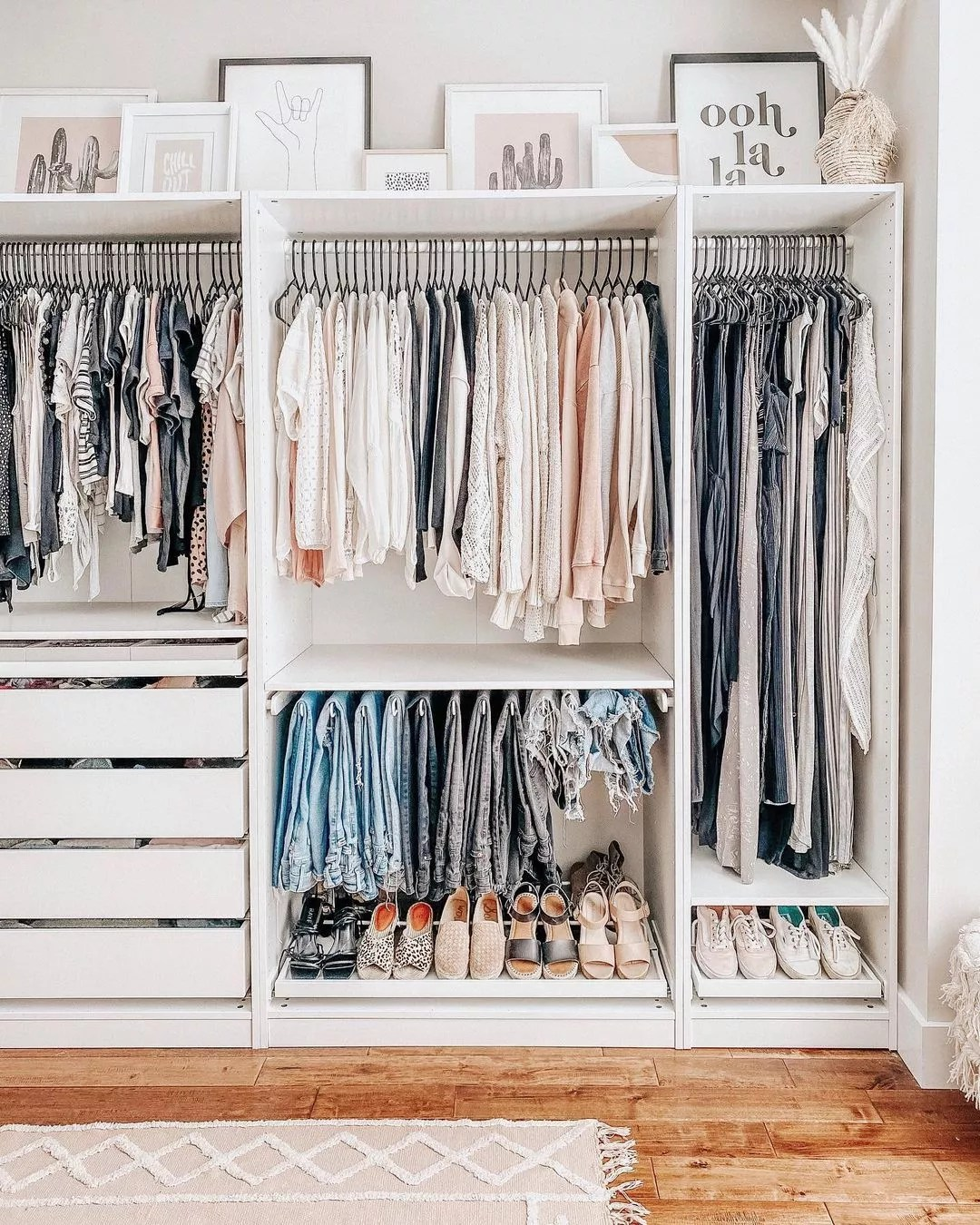 A nicely organized white closet with shoes and clothes. Photo by Instagram user @bymeghang