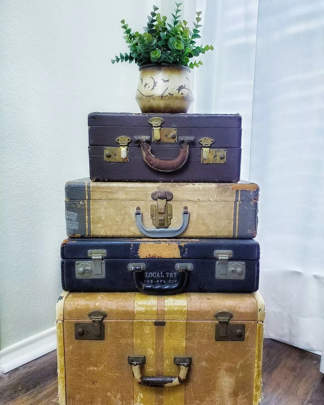 Four stacked trunks used as repurposed decor. Photo by Instagram User @lifeonclearance