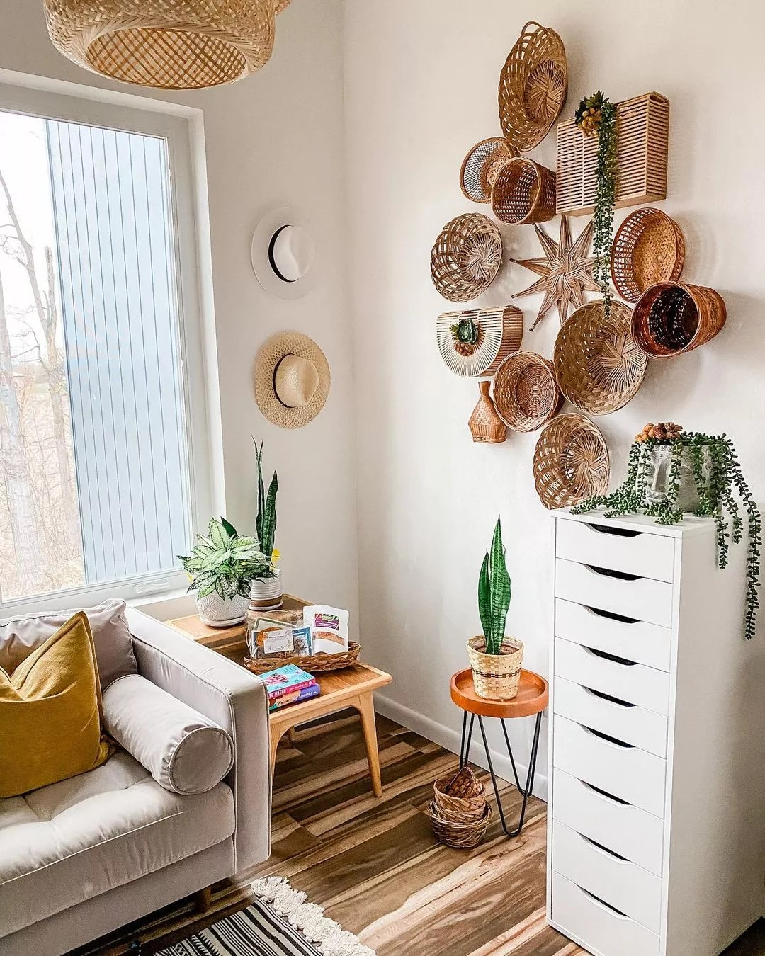 Open room with bamboo and rattan baskets of varying sizes hung on the wall. Photo by Instagram user @angbruening.