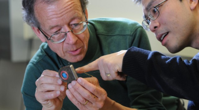 Wireless BCI inventors, Arto Nurmikko and Ming Yin, look thoroughly amazed by their device